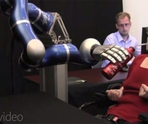 Paralyzed Woman Controls Robotic Arm with Mind